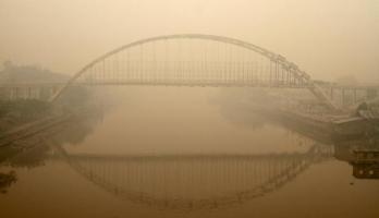 243802_jembatan-siak-iii-ditutupi-kabut-asap-di-pekanbaru--riau_663_382
